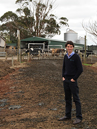 David Swain in front of dairy farm